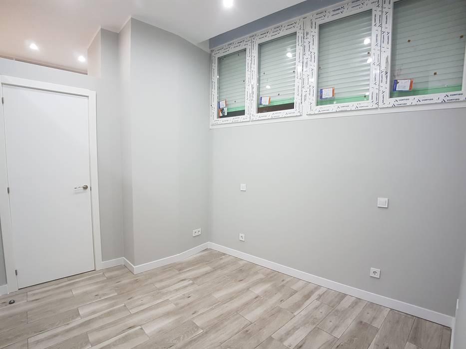 Espacio dormitorio :  de estilo  de M.Angustias Terron