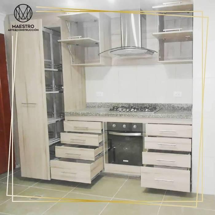 Remodelación cocina de Maestro Arte & Construcción Clásico Aglomerado
