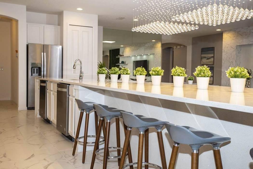 Ambientes compartilhados Flávia Gueiros Cozinhas modernas Mármore Cinza