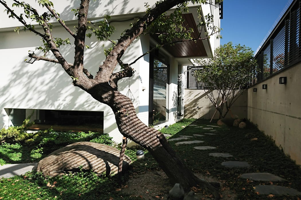 黃耀德建築師事務所  Adermark Design Studio:  tarz Kayalı bahçe,