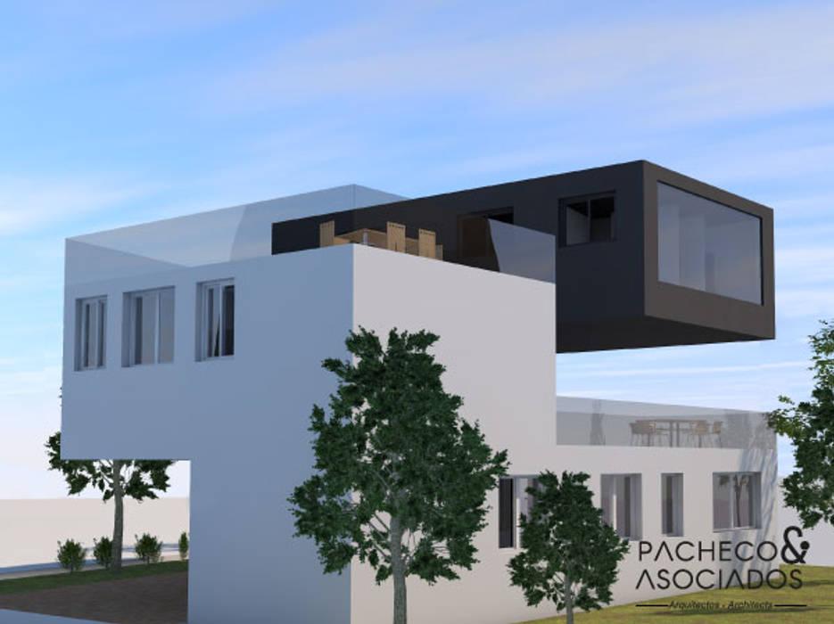 Fachada: Casas unifamilares de estilo  de Pacheco & Asociados,