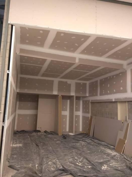 Avances de construcción en los primeros 7 días:  de estilo  por Faerman Stands y Asoc S.R.L. - Arquitectos - Rosario