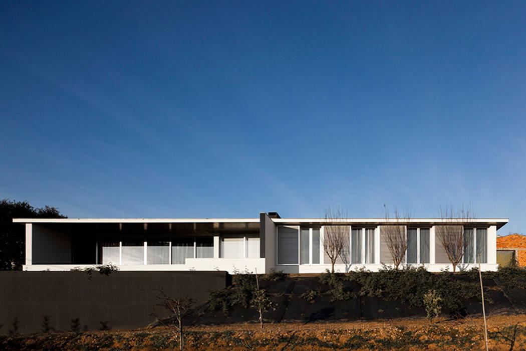 Projecto Xieira I: Casas unifamilares  por A2+ ARQUITECTOS