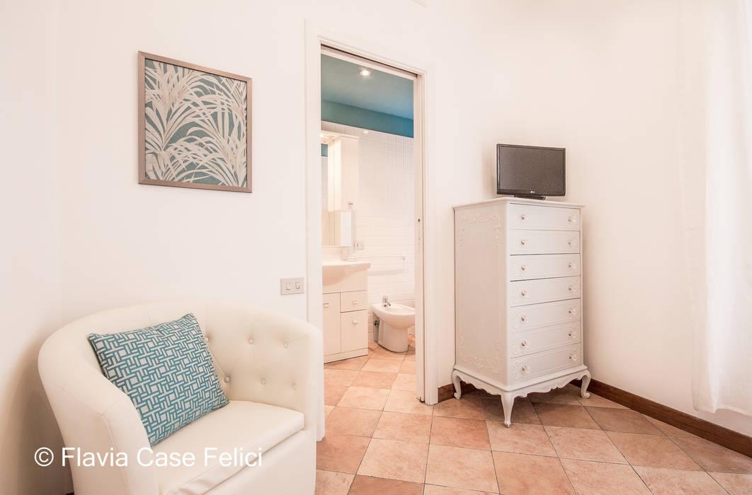 A DUE PASSI DA SAN PIETRO Camera da letto moderna di Flavia Case Felici Moderno