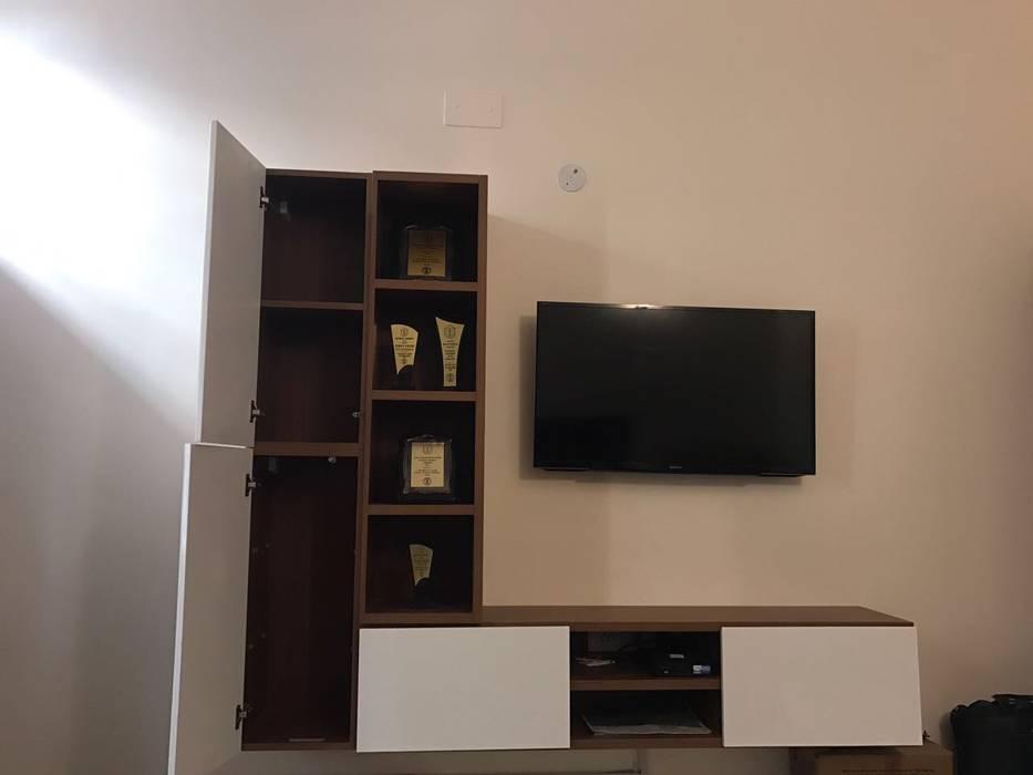 Tv unit cum storage unit:  Bedroom by TheMistris