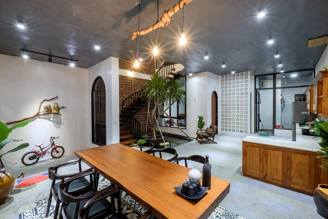 PH - House:  Phòng khách by Mét Vuông