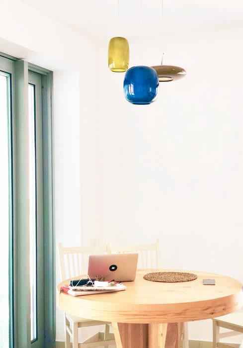 Esempio di lampade Siru per interni: Negozi & Locali Commerciali in stile  di siru srl