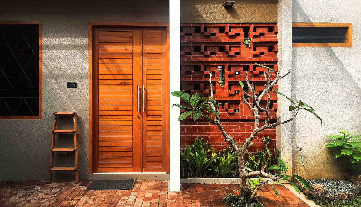Komposisi material Dinding & Lantai Tropis Oleh Mandalananta Studio Tropis Batu Bata