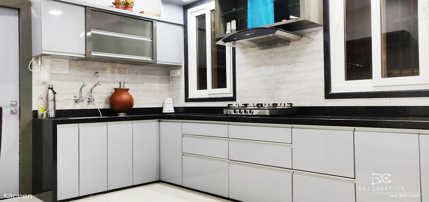 Brijdham (Bungalow):  Kitchen by Raj Creation