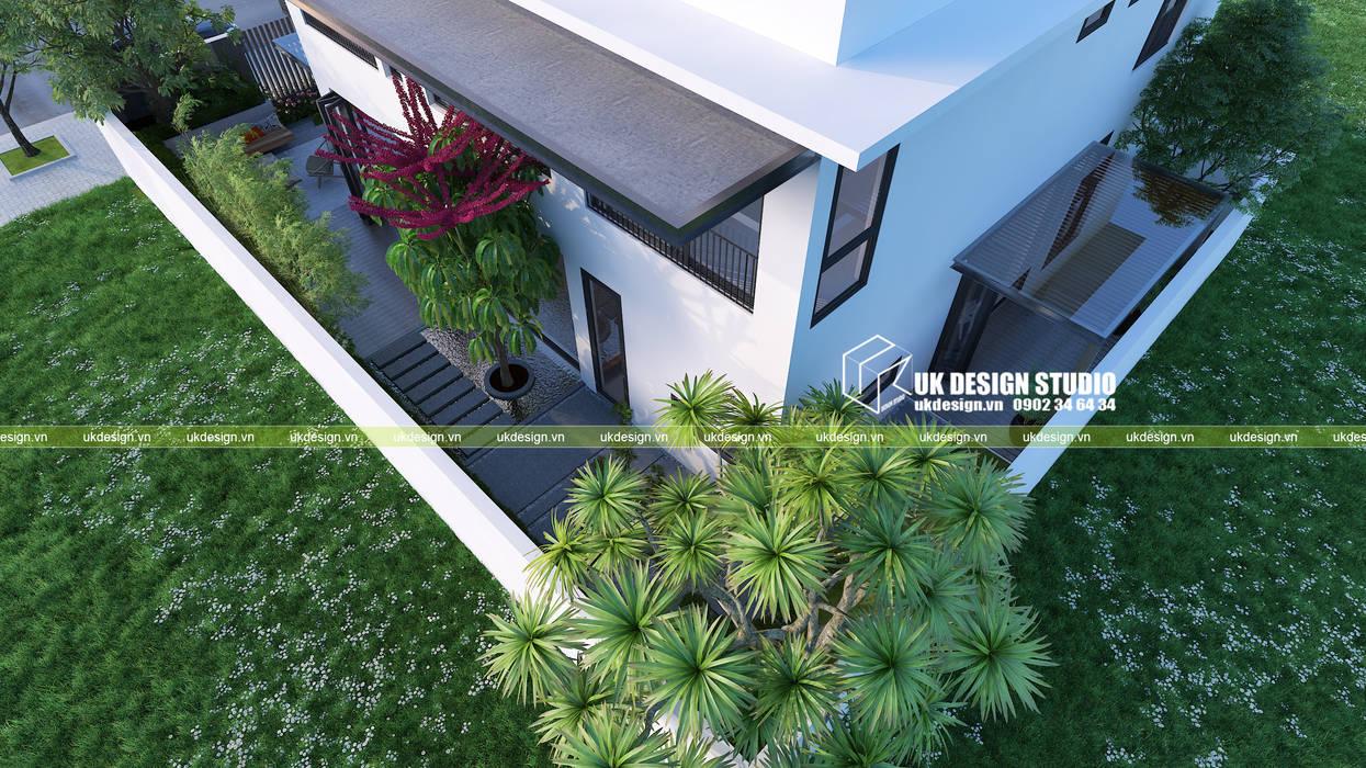 Hành lang sân vườn biệt thự Hành lang, sảnh & cầu thang phong cách hiện đại bởi UK DESIGN STUDIO - KIẾN TRÚC UK Hiện đại