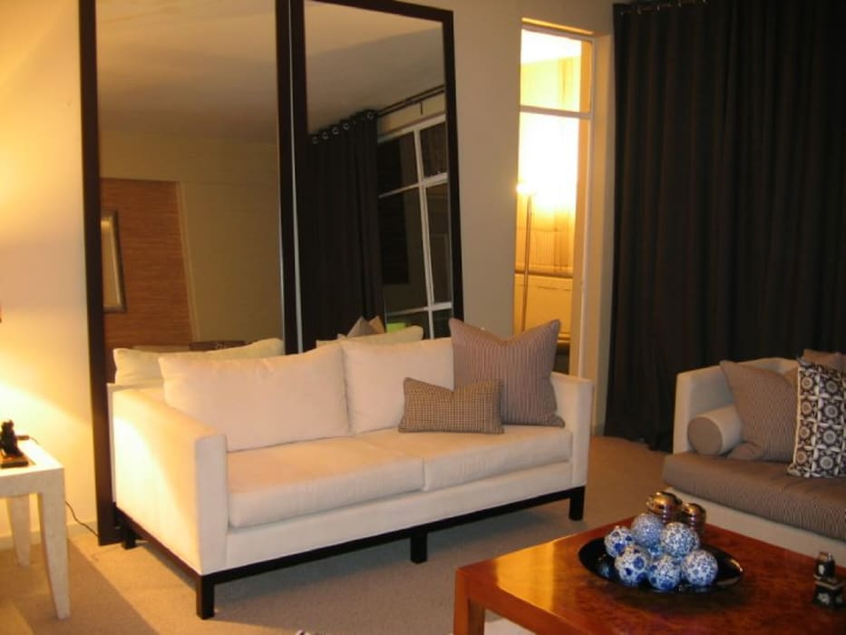 Polo Sofa with tall mirrors by CKW Lifestyle Associates PTY Ltd Eclectic