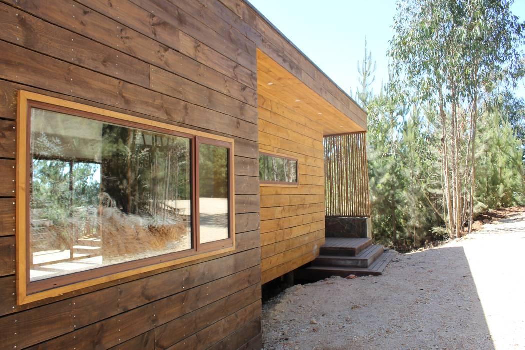 KIMCHE ARQUITECTOS Chalés e casas de madeira Madeira
