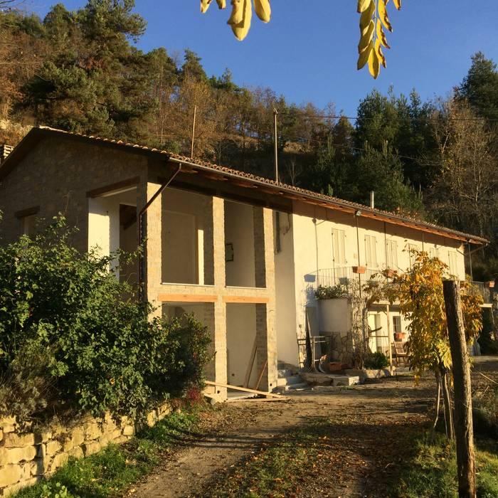Aanbouw woning Italië:  Huizen door TEKTON architekten,