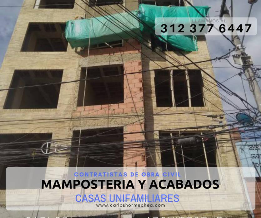 MAMPOSTERIA Y ACABADOS: Conjunto residencial de estilo  por CARLOS HORMECHEA ARQUITECTURA,