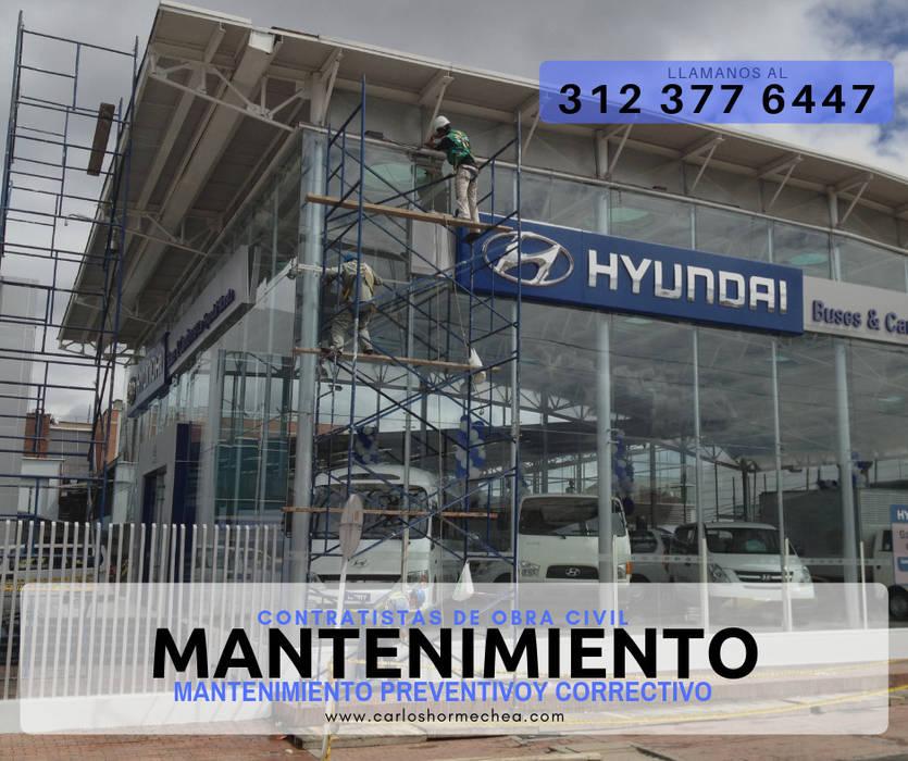 MANTENIMIENTO DE FACHADAS: Conjunto residencial de estilo  por CARLOS HORMECHEA ARQUITECTURA,