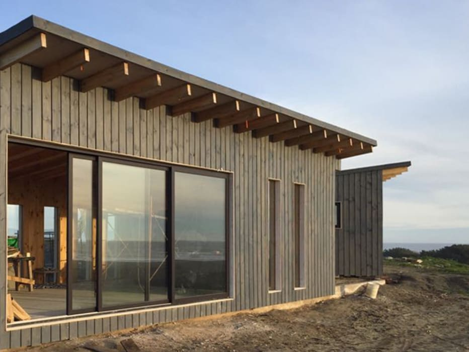 Cabaña en Santos del Mar: Casas de madera de estilo  por AtelierStudio, Moderno