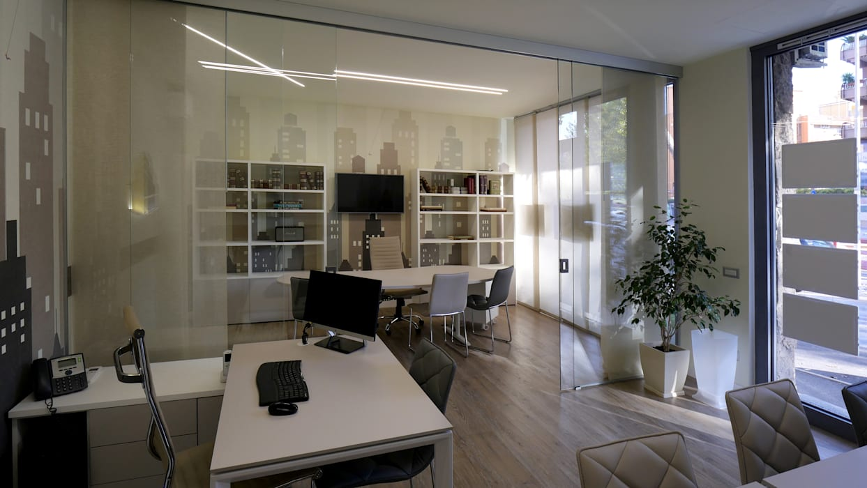 spazi ben definiti: Spazi commerciali in stile  di Pamela Tranquilli Interior Designer