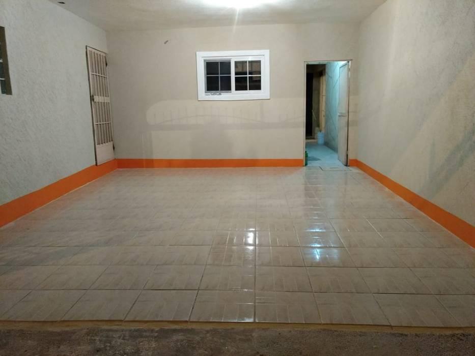 piso cochera : Garajes abiertos de estilo  por Constru-Acción