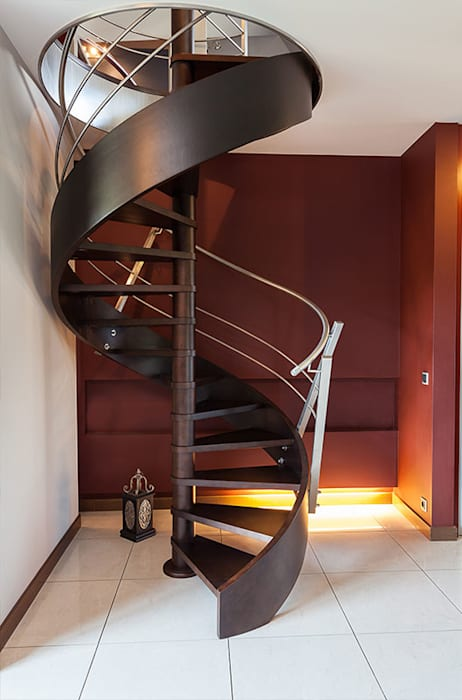 Metal Spiral Staircase:  Stairs by Renov8 CONSTRUCTION