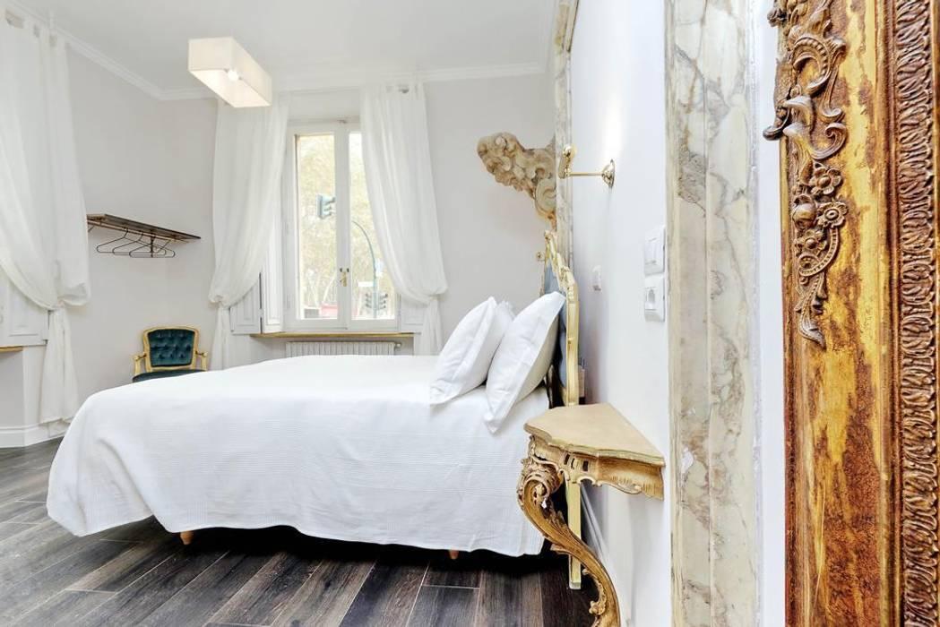 Camera da letto: Camera da letto in stile  di Grippo + Murzi Architetti, Moderno