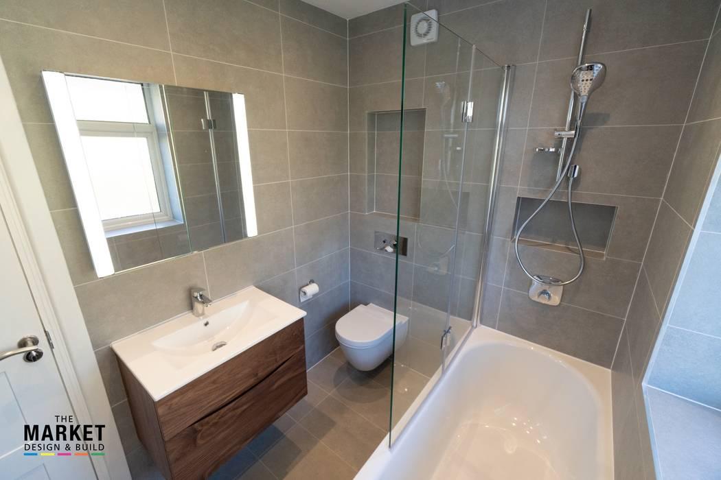 EALING LOFT CONVERSION:  Bathroom by The Market Design & Build,