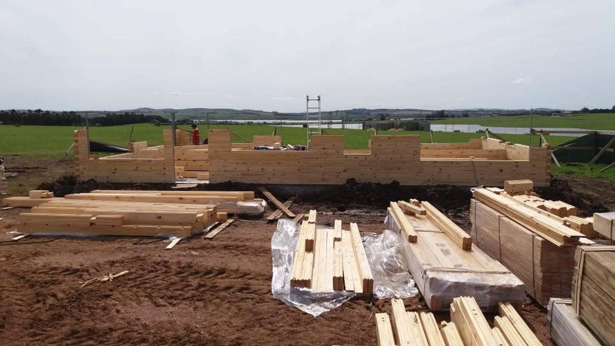 Proceso de construcción: Casas de estilo  por Patagonia Log Homes - Arquitectos - Neuquén