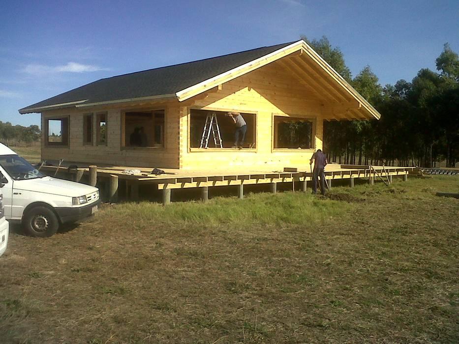 by Patagonia Log Homes - Arquitectos - Neuquén Rustic