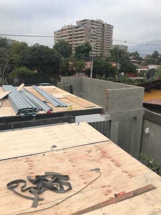 Remodelación y Ampliación de una casa en Santiago: Casas de estilo  por ARquitectura