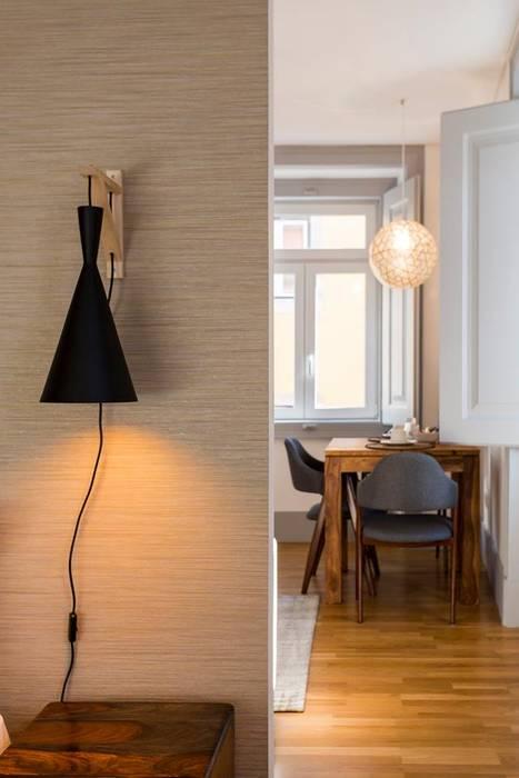 Zona do quarto com vista para refeição: Casa  por Traço Magenta - Design de Interiores