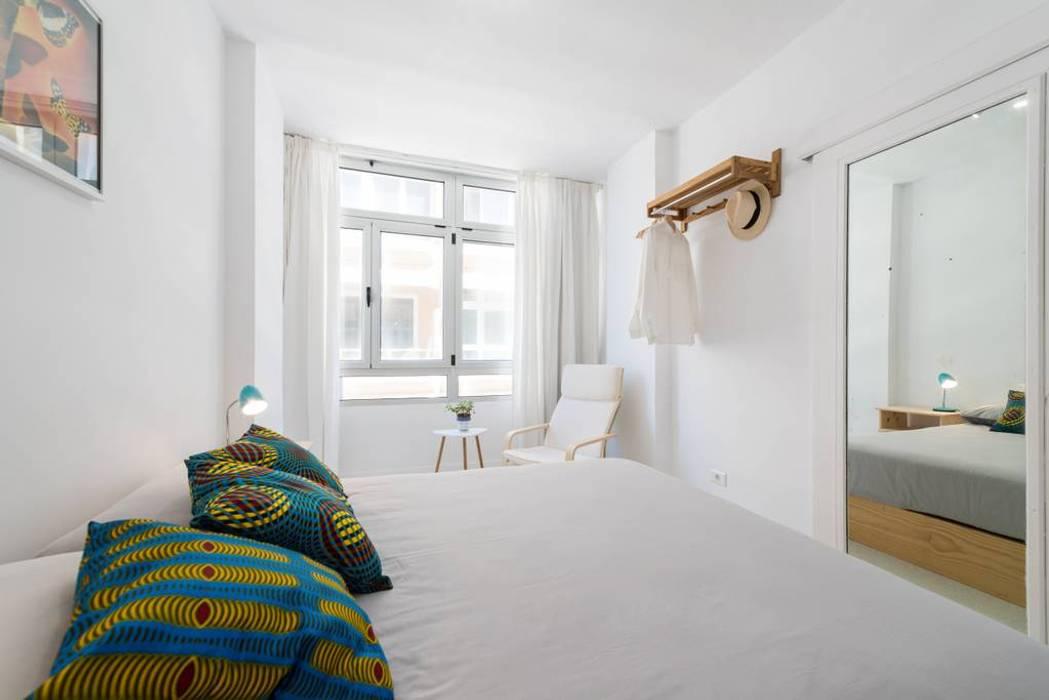 Reforma de vivienda vacacional, Sorimba Beach de SMLXL-design Minimalista