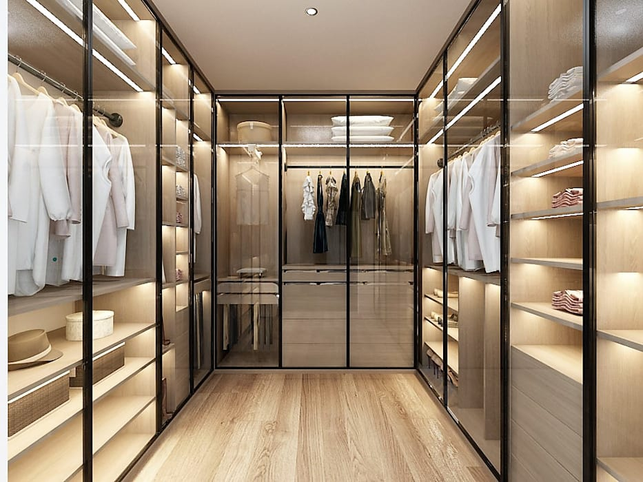 獨立的更衣室有龐大的收納空間:  更衣室 by 台中室內設計-築采設計