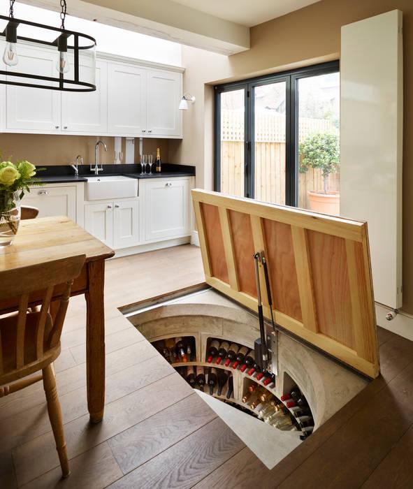 Original Spiral Cellar with concealed timber door :  Wine cellar by Spiral Cellars