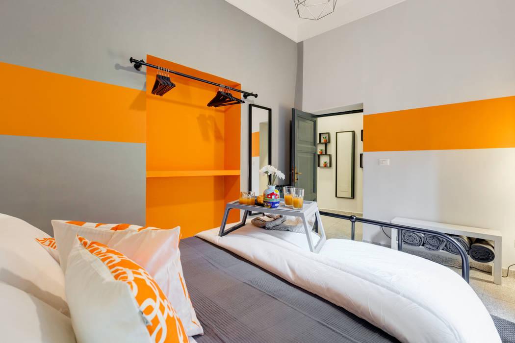 Creattiva Home ReDesigner - Consulente d'immagine immobiliare Industrial style bedroom