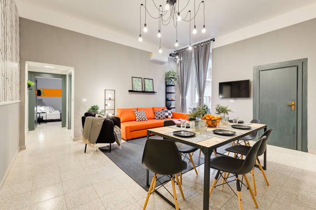Appartamento adibito a casa vacanza: Sala da pranzo in stile  di Creattiva Home ReDesigner  - Consulente d'immagine immobiliare