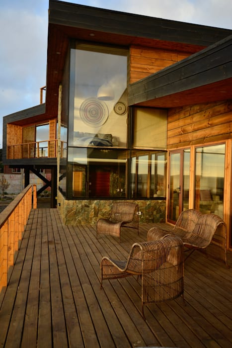 Wooden houses by Kimche Arquitectos , Modern Wood Wood effect