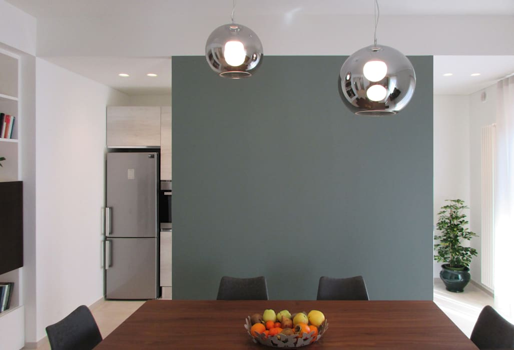 Parete pranzo: Pareti in stile  di B+P architetti, Moderno