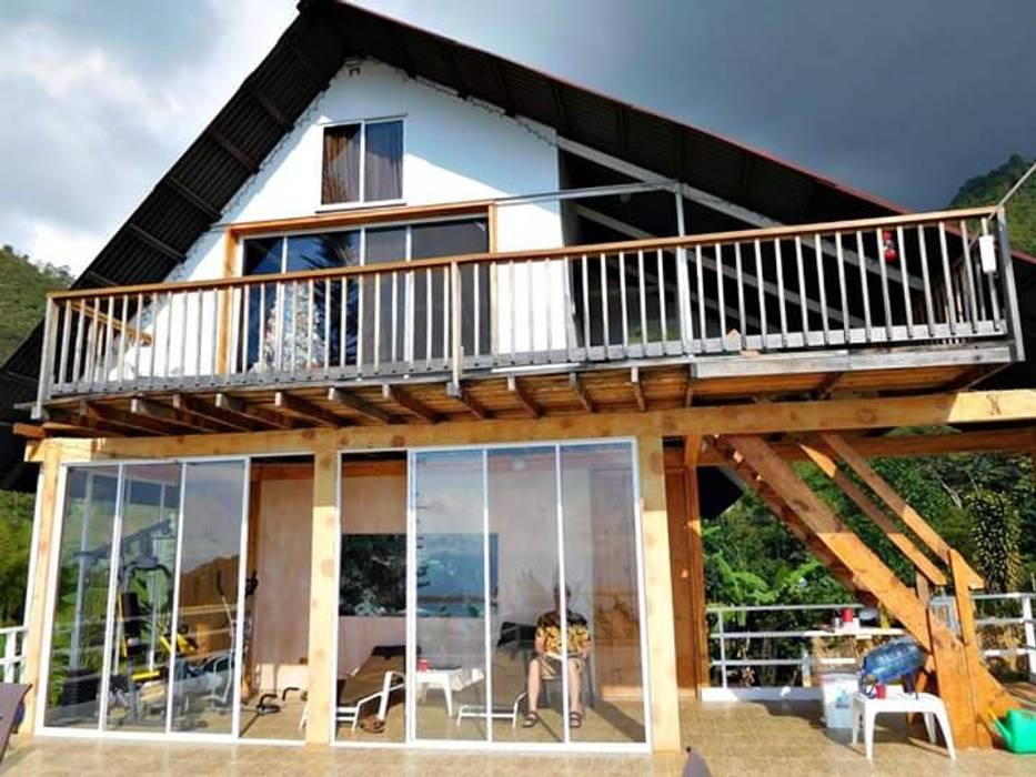 Country house by Brand  Aquitecto interiorista