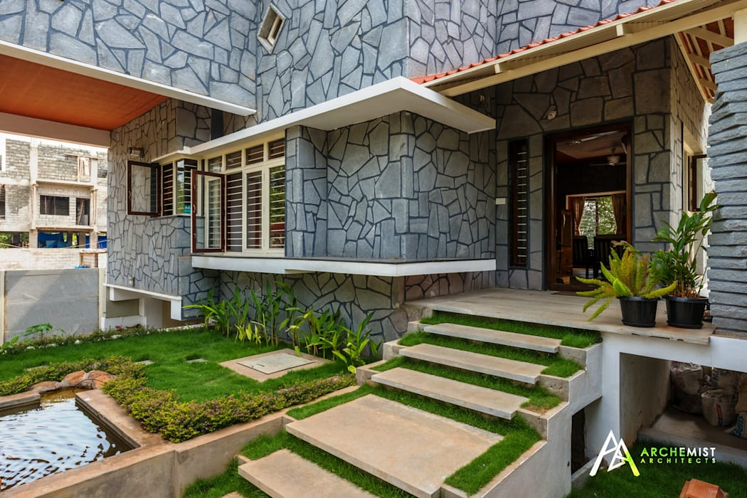entrance view Tropical style garden by Archemist Architects Tropical Stone