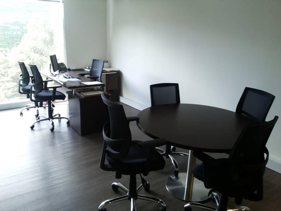 ATH: Edificios de oficinas de estilo  por areaxmetro
