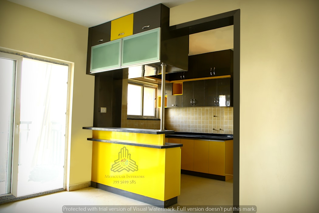 Kitchen with breakfast counter and a crockery unit:  Kitchen units by Meticular Interiors LLP,Modern