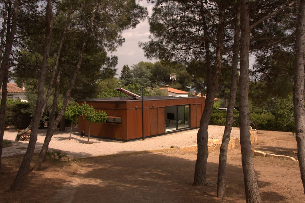 Fachada - Vista lateral: Casas ecológicas de estilo  por INFINISKI
