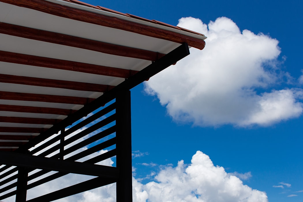 Cubierta zona social - piscina de EVA Arquitectos SAS Minimalista