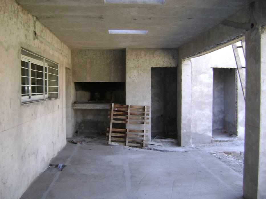 Casas unifamilares de estilo  de Fabiana Ordoqui  Arquitectura y Diseño.   Rosario | Funes |Roldán, Minimalista Ladrillos