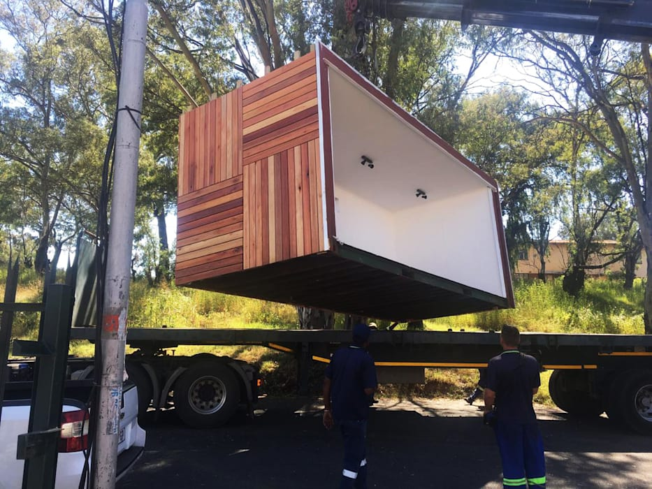 Loading by A4AC Architects Industrial Solid Wood Multicolored
