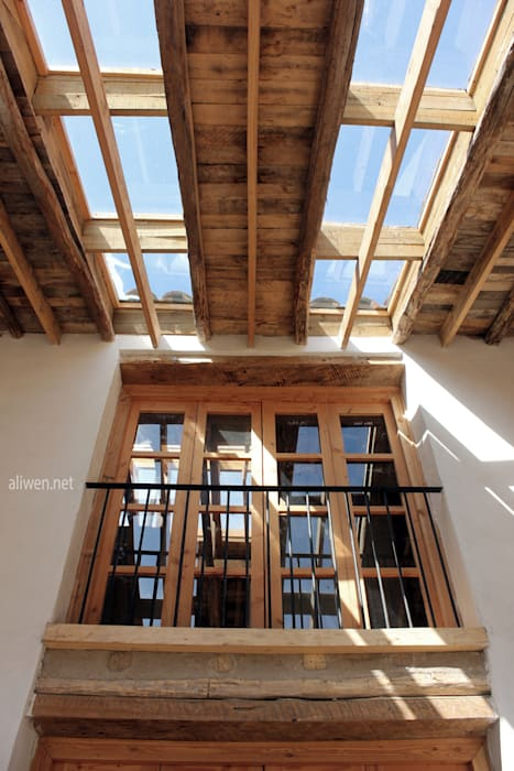 Reparación y Rehabilitación de Galpón en Toquihua por ALIWEN Puertas y ventanas coloniales de ALIWEN arquitectura & construcción sustentable - Santiago Colonial