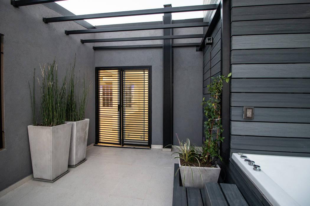 Casa CZM: Jardines de invierno de estilo  por Luis Barberis Arquitectos