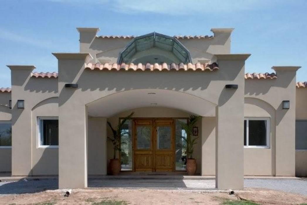 Casa LV: Casas unifamiliares de estilo  por Luis Barberis Arquitectos,Rústico