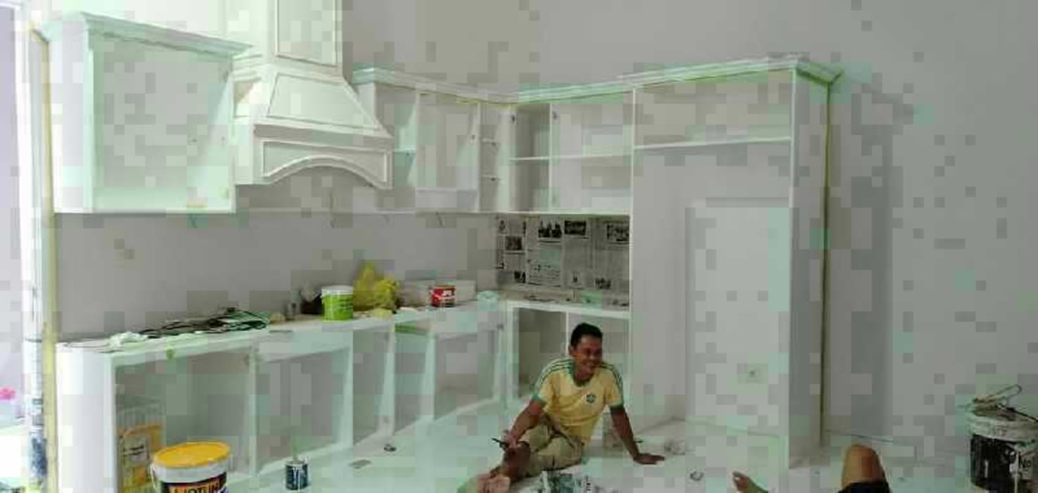 Pembuatan kitchen set: Dinding oleh Harade  Interior,