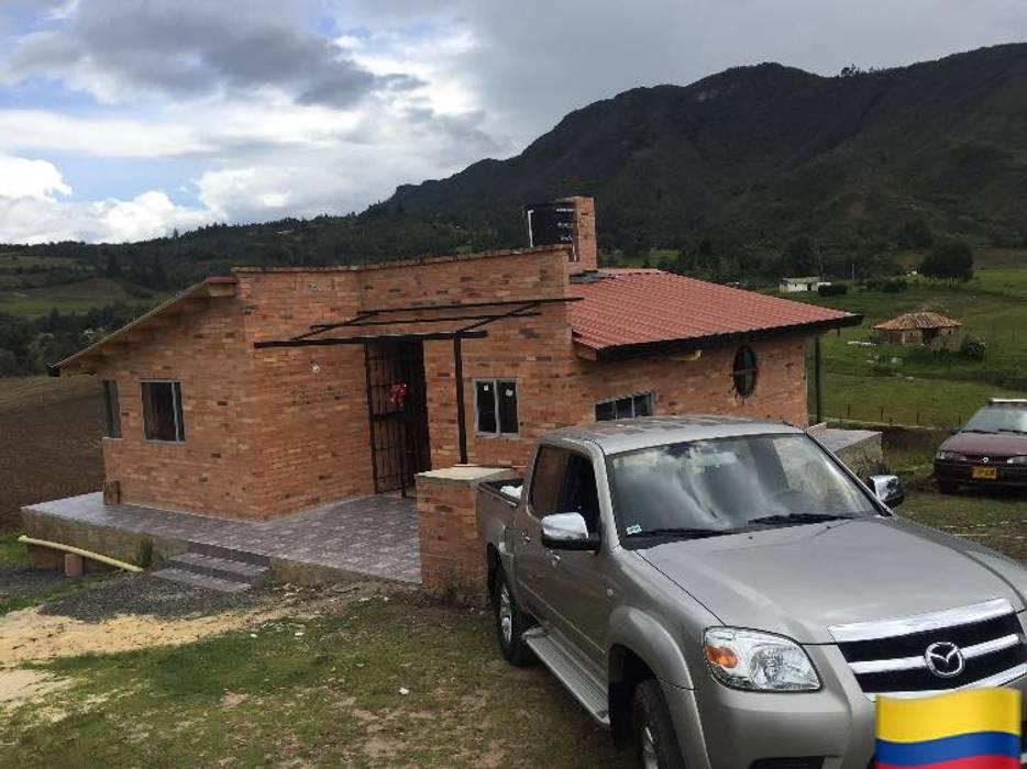 บ้านและที่อยู่อาศัย โดย Lopez Robayo Arquitectos, คันทรี่ อิฐหรือดินเผา