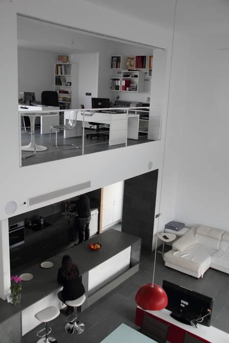 Espacio a doble altura. Estudio1403, COOP.V. Arquitectos en Valencia Livings de estilo moderno